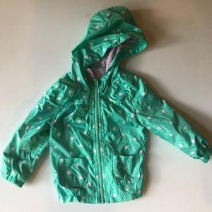 Polka dot rain jacket for toddler.